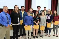 Baker High School students who won an honorable mention award in the scholastic writing competition receive their certificates