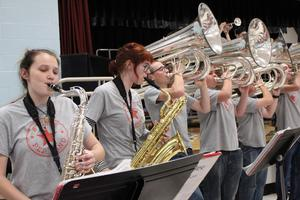 band students play saxophones and tubas