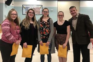 four students hold awards