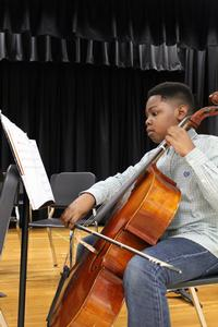 student playing a cello
