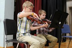 children play the violin