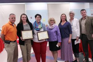 teachers with award plaques