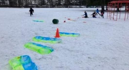 Students enjoy outside & snow play equipment from a community member's donation